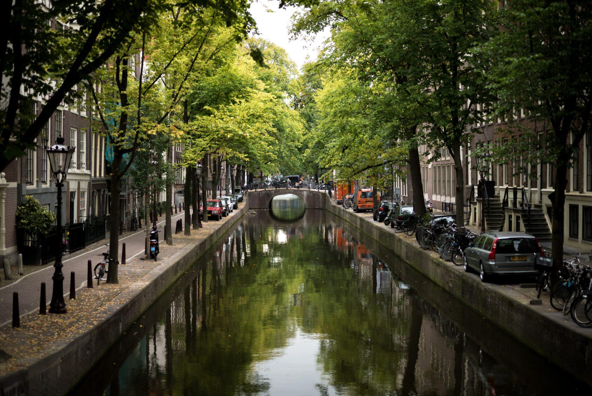 """Amsterdam canal. Photo by Boudewijn """"Bo"""" Boer on Unsplash."""
